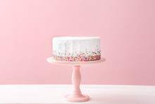 Tasty Birthday Cake On Table Against Color Background