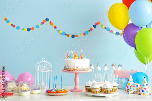 Obraz Tasty candy bar for Birthday party on table against color background - fototapety do salonu