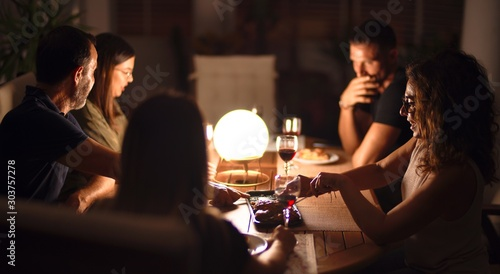 Obraz Beautiful family on dinner talking and smiling at terrace - fototapety do salonu