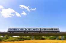 Rapid Metro Train Is Moving By Elevated Railway In Panning Effect Photo Style. Concept Public Electric Transport With Zero Emissions.