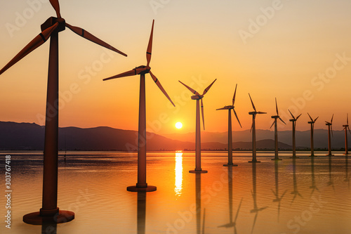 Foto auf Leinwand Orange Renewable energy, wind energy with windmills