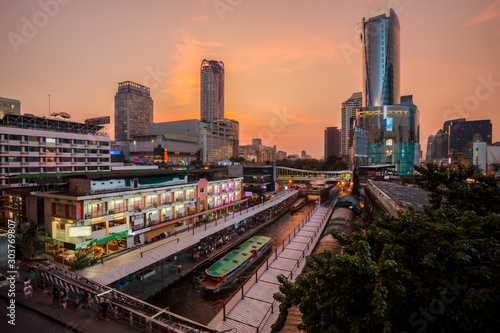 Skyscraper and Pratunam pier in Bangkok; water transportation by speed boat is one of the alternative choice for solving the traffic congestion problem in Bangkok.