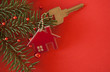 canvas print picture - Christmas decoration: decorative house and key to the lock. Concept of finance and housing loans