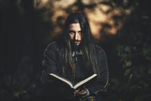 A Man With Long Hair And Beard...