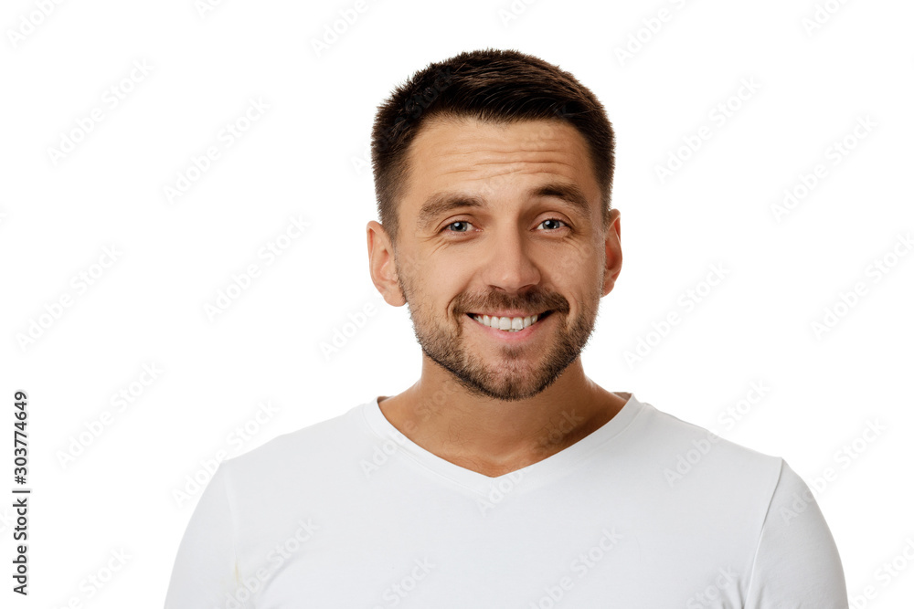Fototapeta Close-up portrait of smiling handsome bearded man in white shirt looking at camera isolated on white background