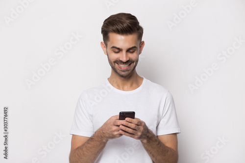 Close up portrait with handsome bearded man received good news.