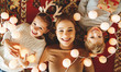 canvas print picture Happy family mother and children with Christmas   garland.
