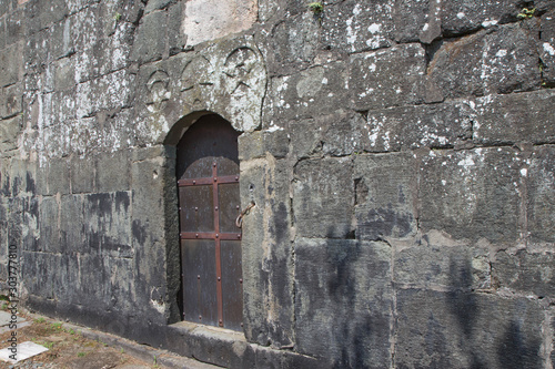 Fototapety, obrazy: Closed Old metal, iron Door In A Wall. Doorway of a thirteenth century medieval castle