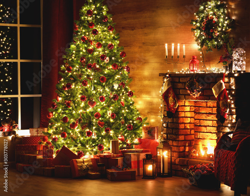Poster Countryside interior christmas. magic glowing tree, fireplace, gifts in dark