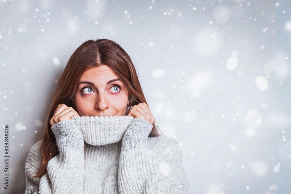 Fototapeta Portrait of a happy young woman in warm cozy sweater.