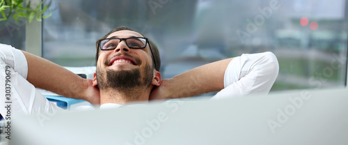 Handsome smiling bearded adult clerk person arms crossed - fototapety na wymiar