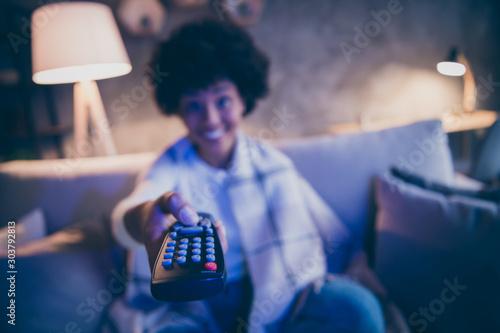 Fotografija Blurred photo of positive cheerful afro american girl sit divan watch cinema mov