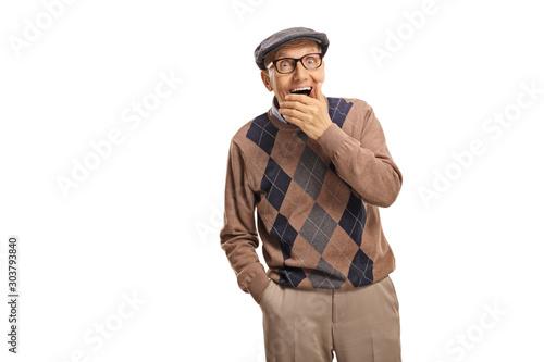 Amazed senior man holding his mouth