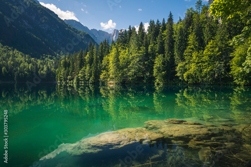 Spring landscape at Lake Fusine on the slopes of the Julian Alps, Tarvisio, Ital Wallpaper Mural