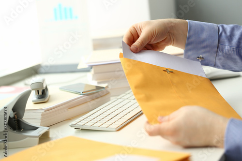 Foto Businessman hold hand yellow mail envelope