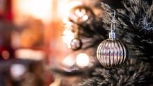 Silver Christmas Ball On Branc...