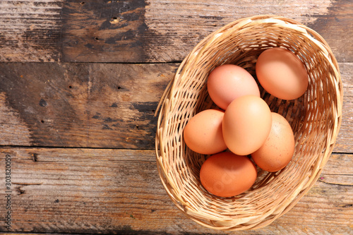 raw egg in box on wood background Canvas Print