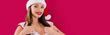 Smiling Sexy Beautiful Santa Girl Showing Thumbs Up Isolated On Burgundy, Panoramic Shot