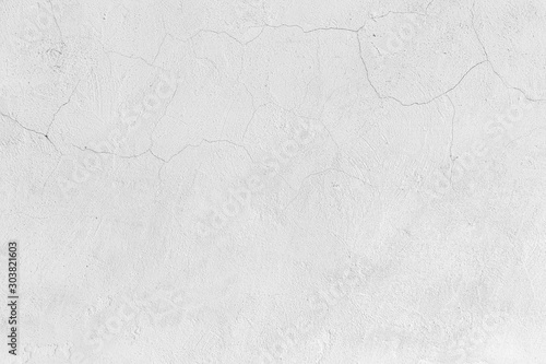Fotomural  Rough white relief stucco with cracks wall texture background