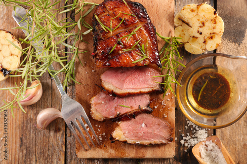 roasted duck breast and slice on wooden board Fototapeta