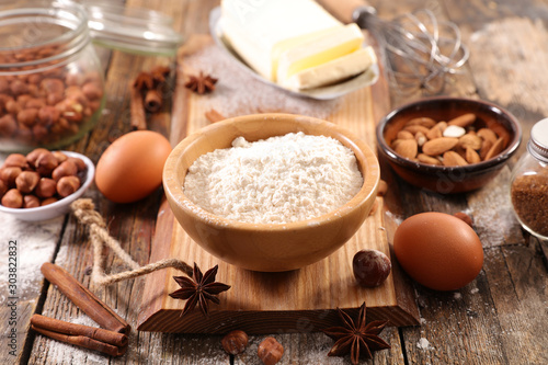 Photo  baking food ingredient on wooden board, flour-egg-nut-butter and spices
