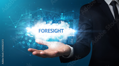 Poster Pays d Europe Hand of Businessman holding FORESIGHT inscription, successful business concept
