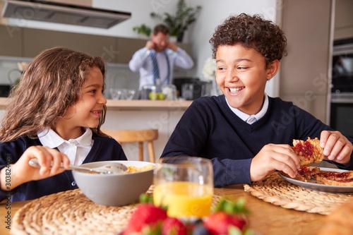 Foto op Aluminium Kruidenierswinkel Businessman Father In Kitchen Helping Children With Breakfast Before Going To School