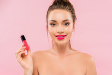 Smiling Naked Beautiful Woman With Pink Lips Holding Lip Gloss Isolated On Pink