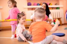 Nursery Children With Trainer ...