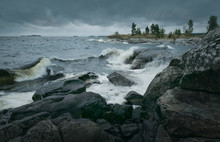 Waves Of Stormy Sea Break On Rocky Shore. Horizontal Layout