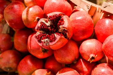 Ripe pomegranates in a basket at the market. Seasonal fruits