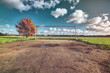 canvas print picture - soccer goal with tree, skyline and cloudscape