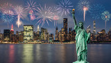 Fototapeta Nowy Jork - statue of liberty in front of Manhattan skyline,in Dumbo area of Brooklyn at night, and fireworks