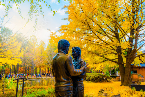 Foto auf Leinwand Orange Statue and Tourists taking photos of the beautiful scenery around at Nami Island in seoul,South Korea,19 November 2019.