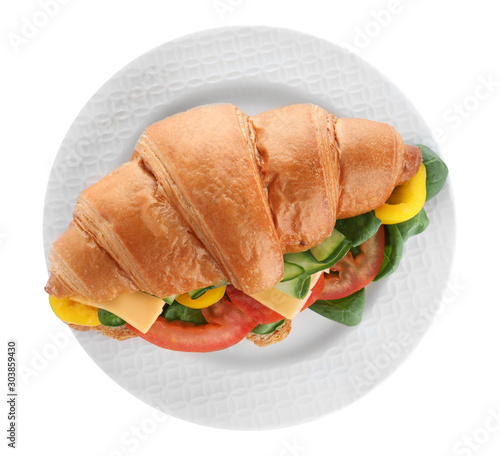 Obraz na plátně  Plate with tasty vegetarian croissant sandwich isolated on white, top view
