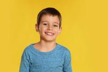 Portrait Of Happy Little Boy On Yellow Background