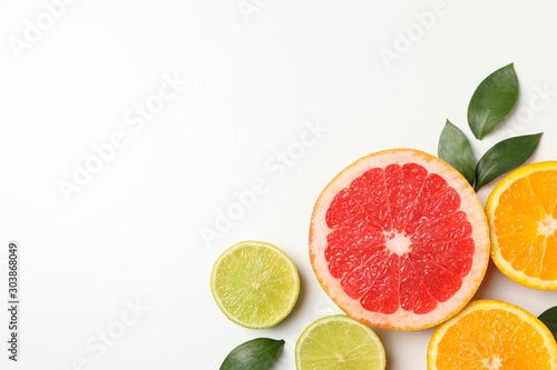 Fotografía  Flat lay with exotic fruits on white background, top view