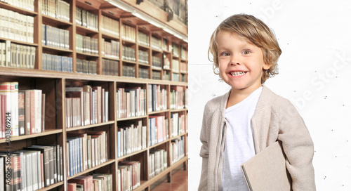 Very cute little boy with a book in his cardigan