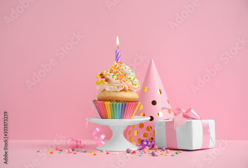 Obraz na plátně  Composition with birthday cupcake on pink background