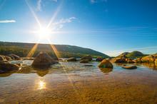 Sun Shining Over Rocks On Jord...