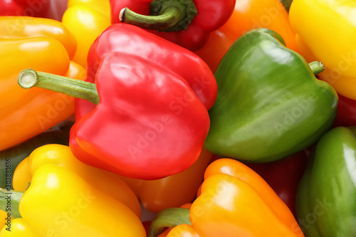 Carta da parati Fresh ripe colorful bell peppers as background, closeup