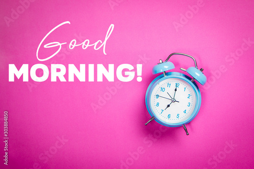 Retro blue pastel alarm clock on a pink background with quote Good morning Canvas Print