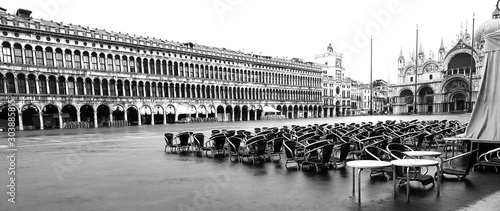 alfresco cafe with tables and chairs under the water in Venice I Wallpaper Mural