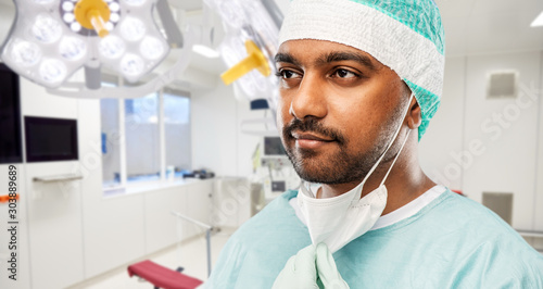 Fotomural  medicine, surgery and people concept - close up of indian male doctor or surgeon