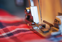 Close-up Of Sewing Machine And...