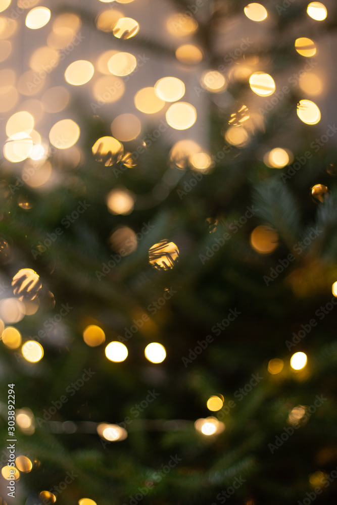 Fototapety, obrazy: Blurred photo of Christmas tree shining with lights of garland