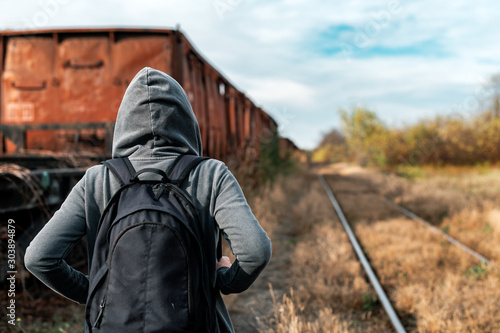 Homeless woman with backpack getting away from it all