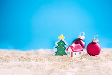 Miniature House With Red Roof On Tropical Sand Beach And Decoration Christmas Tree.Image For Property Real Estate Investment Concept.