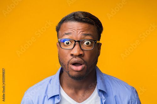 Surprised African American Guy Looking At Camera Posing, Yellow Background Canvas Print