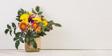 Bouquet Of Flowers In A Vase On A White Table, Copy Space Banner.